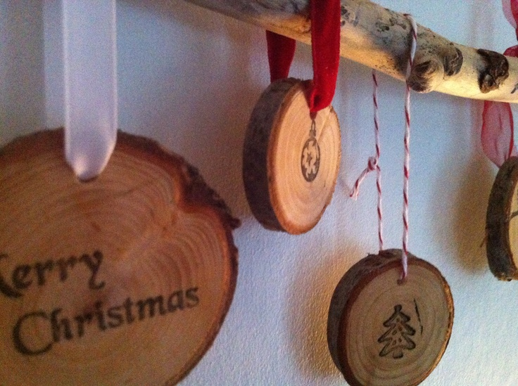 Natural christmas ornaments could use ink and stamps to put a design on tree slices