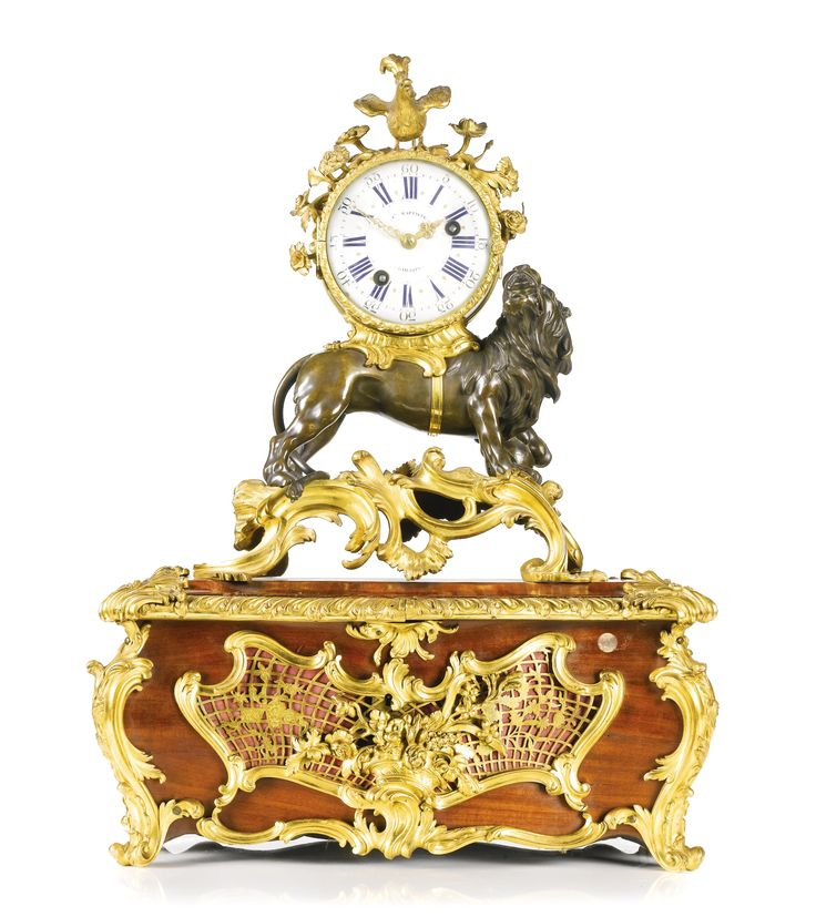 A LOUIS XV ORMOLU AND PATINATED BRONZE MANTEL CLOCK, FRENCH, CIRCA 1745 ON AN ASSOCIATED CASKET BASE