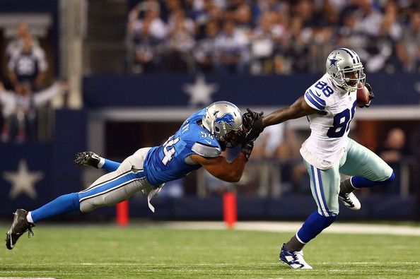 Dez Bryant #88 of the Dallas Cowboys breaks away from DeAndre Levy #54 of the Detroit Lions during the second half of their NFC Wild Card Playoff game at AT&T Stadium on January 4, 2015 in Arlington, Texas. (January 3, 2015 - Source: Ronald Martinez/Getty Images North America)
