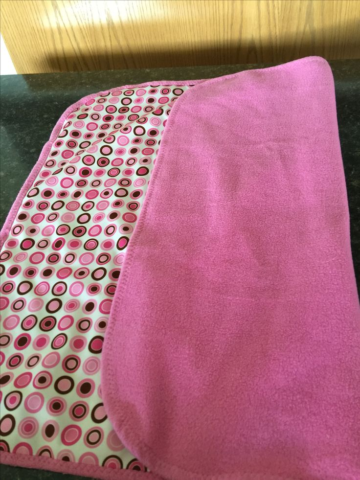 Change pad made for Piper (granddaughters) in 2015 with baby vinyl and polar fleece