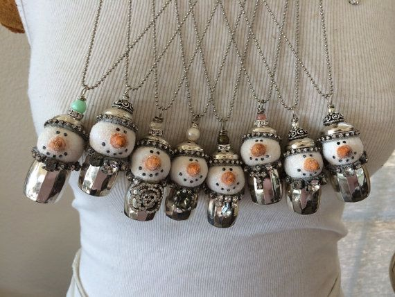 I have hand sculpted the cute little snowman and placed him in a Sterling Silver vintage Salt Shaker. This necklace is so cute to wear! It is very cute layered with other necklaces or worn alone. The snowman has white and crystal glass glitter that catches the light like real snow. This snowman comes with a 24 ball chain. There will never be two of these the same, these are so unique. Each piece is an original <3 <3 <3 This listing is for ONE NECKLACE, I have included a group pictur...