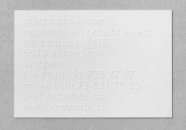 Redwhite business card with blind emboss detail designed by Demien Conrad.