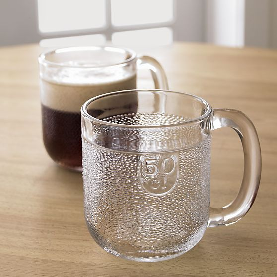 The comeback of a Scandinavian quaffing classic. Iittala's textured Finnish beer mug designed by Oiva Toikka in 1973 features a friendly broad shape, smooth polished rim and embossed measurements. Put beer mugs in the freezer for especially frosty brews.