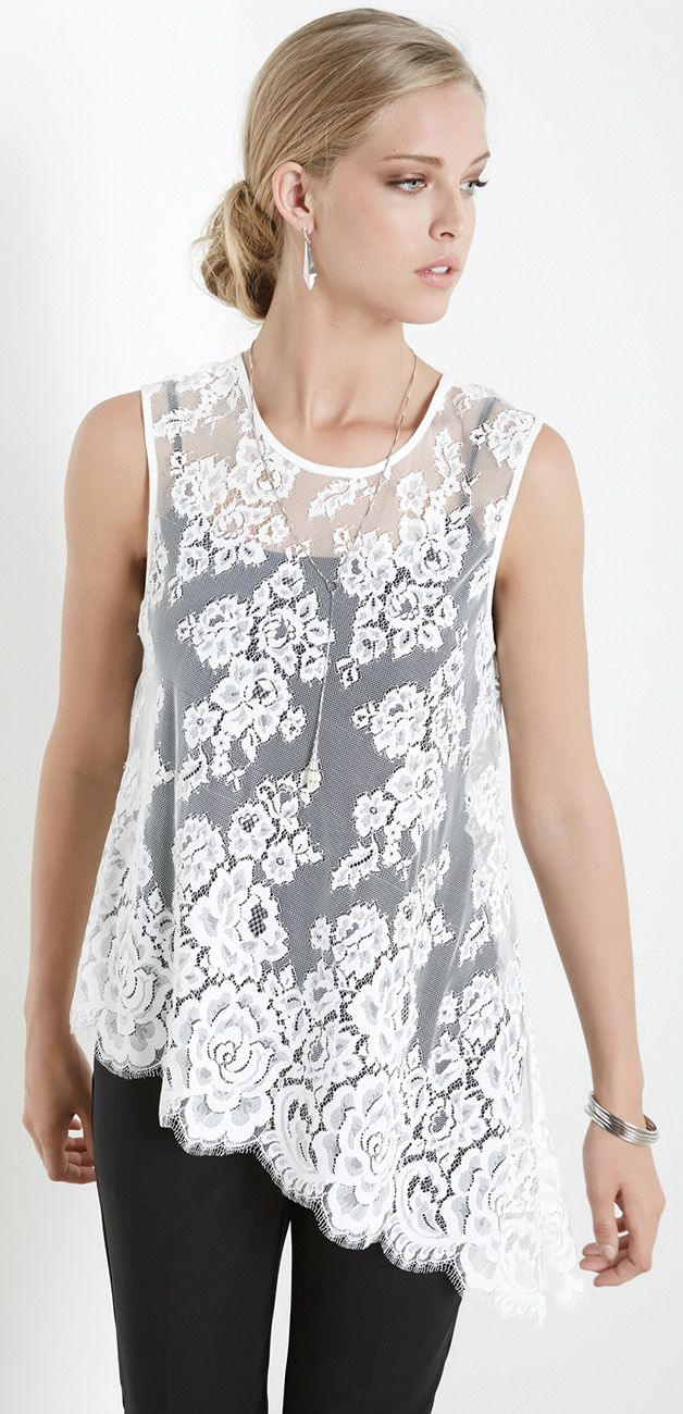 A sleeveless top in always-classic lace is given a modern twist with a sharply-angled asymmetric hem.