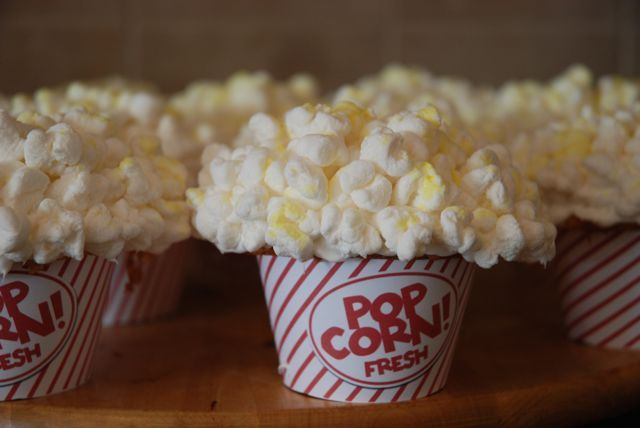 """Popcorn cupcakes"".. What a cute decoration idea! The marshmellows actually look like popcorn."