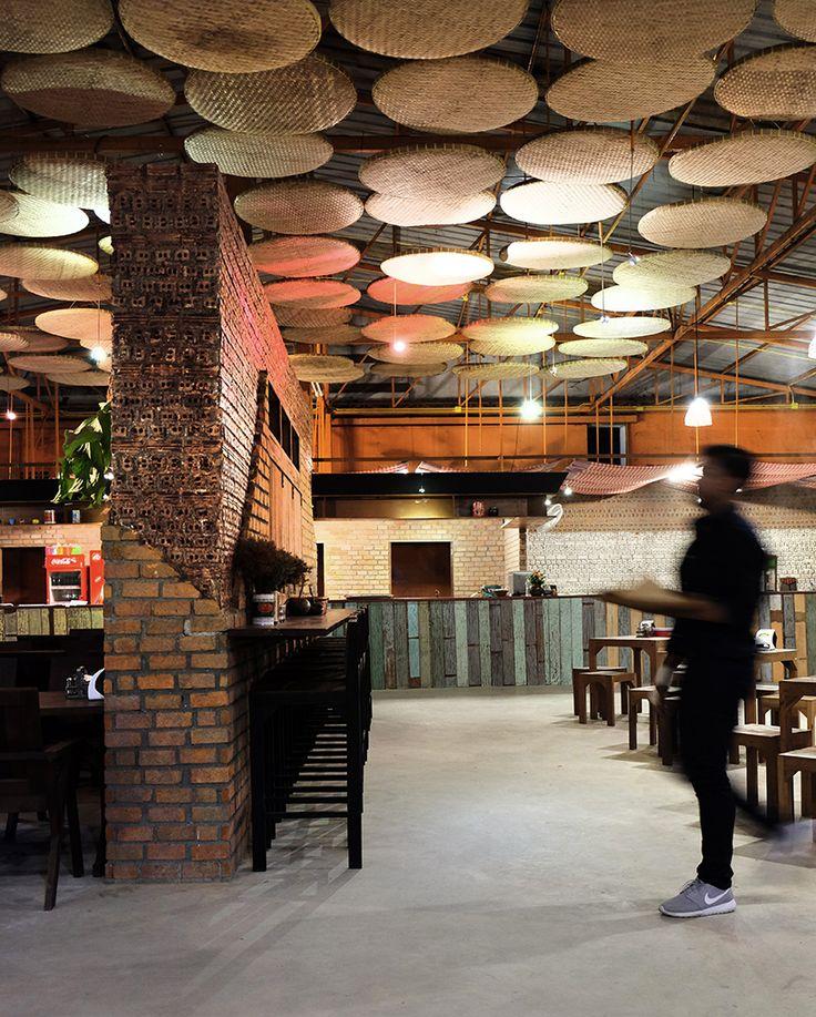thaipan studio transforms warehouse into noodle restaurant in thailand