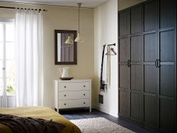 PAX black-brown wardrobe with HEMNES black-brown doors and KOPPANG white chest of drawers