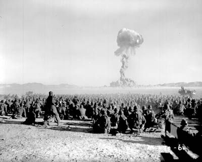 """November 1951 nuclear test at Nevada Test Site. Test is shot """"Dog"""" from Operation Buster, with a yield of 21 kilotons of TNT (88 TJ). It was the first U.S. nuclear field exercise conducted on land; troops shown are 6 mi (9.7 km) from the blast."""