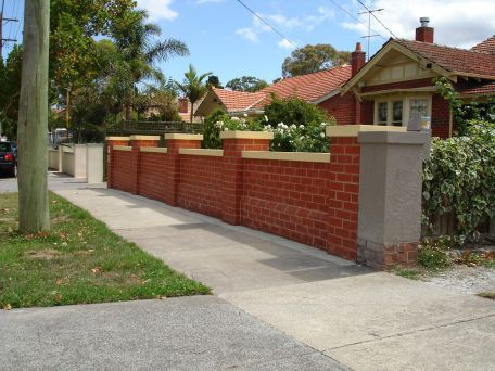 Classic Red Brick Fence With Capping Stone Coloured To