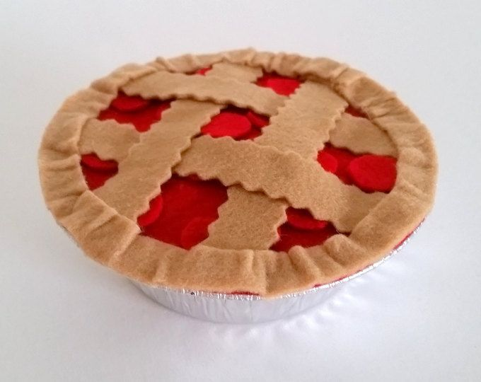 1 realistic felt blueberry pie in aluminum tin. Perfect for play kitchens and little hands! Measures 5 inches diameter, 1.75 inches high. Spot clean only.