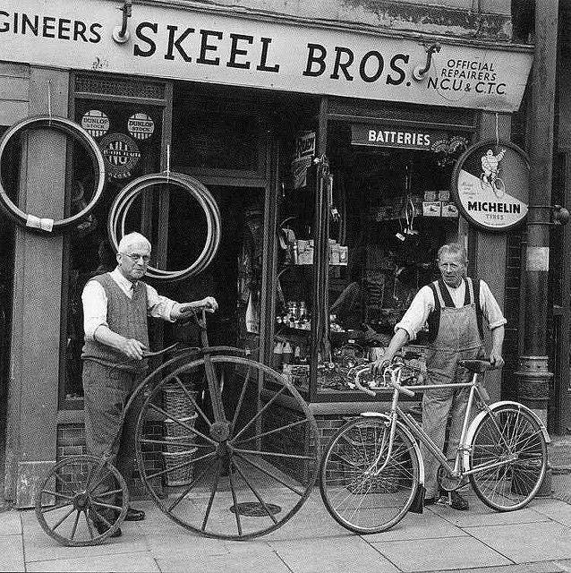 Old bicycle shops, London & UK. Photo b/w. Oldie, old bikes, cool wheels, history.