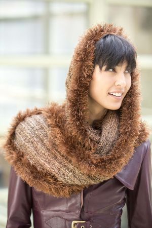 DIY This Cosy Fashion Hooded Furry Scarf. It is very soft, warm and a real Winter Hit! :-D The Scarf is Knitted, and The Fun Fur border is crocheted onto the finished scarf. FREE PATTERN! Provided by Lionbrand.com/patterns/80397AD.html
