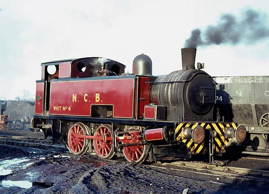 "Hudswell Clarke No.1844 of 1951, a 17"" outside cylinder 0-6-0. The loco, given the number WHIT No.4, is seen at Water Haigh Colliery, Woodle..."