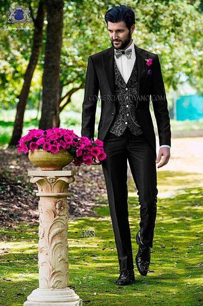 Traje negro para una boda de dia