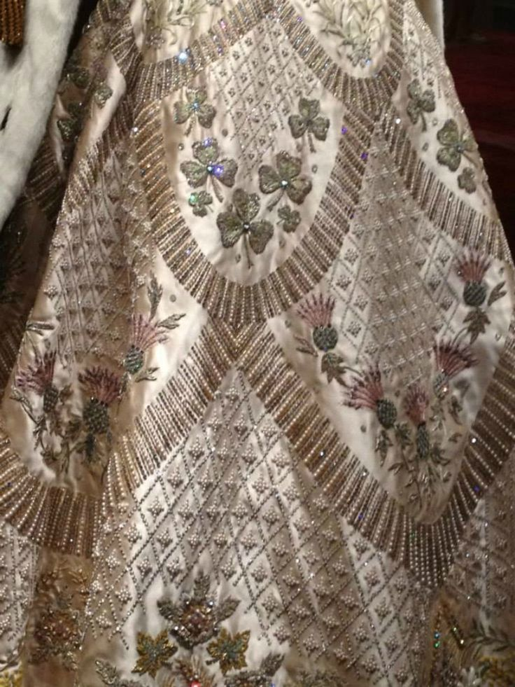 MYROYALS  FASHİON: 'The Queen's Coronation 1953' exhibition at Buckingham Palace in London has opened:  close-up of the embroidery and beading on the Queen's Coronation gown