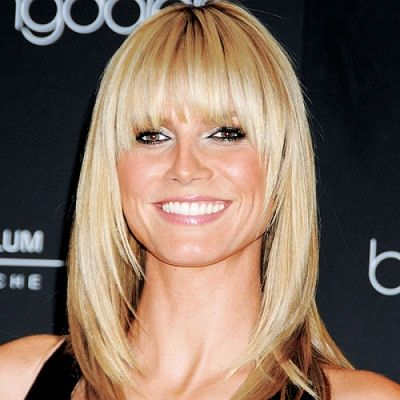Heidi Klum looks fabulous with her medium length blond feathered hairstyle with straight layered bangs. This hairstyle is a great look for any women with a heart or squared shaped face.