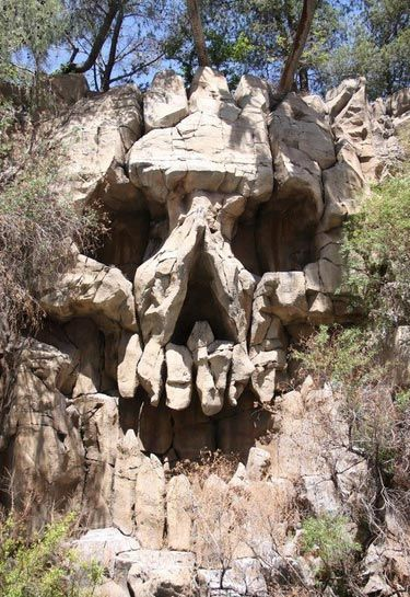 Hillside Skull Shaped Rocks  ... Face on the Mountain - photo by inspirationfeed