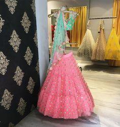 Stunner!! Beautiful pink color lehenga and sea greaan color designer lehenga from Banjara By Mrunalini Rao.Drop by Mrunalini Rao studio in Hyderabad to shop these opulent bridal lehengas. 04 August 2017