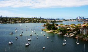 Harbouring ideas … outlook from Gladesville bridge over Cockatoo Island to Sydney's central business district. New South Wales, Australia.