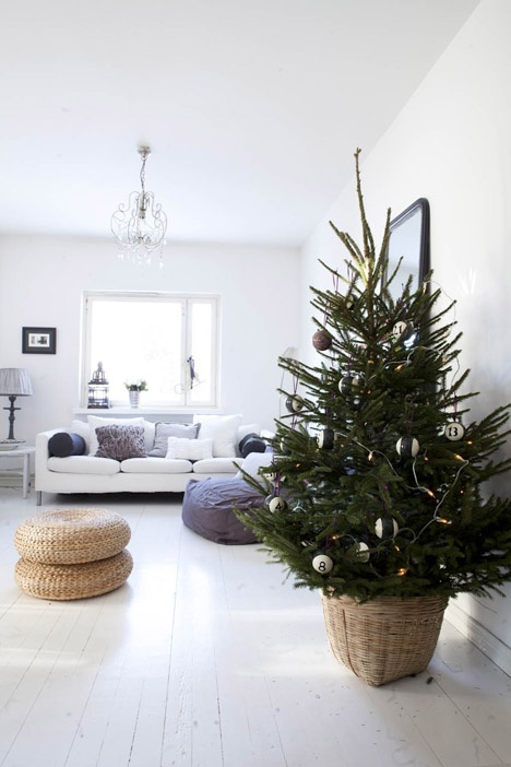 all white home + Christmas tree in a basket stand