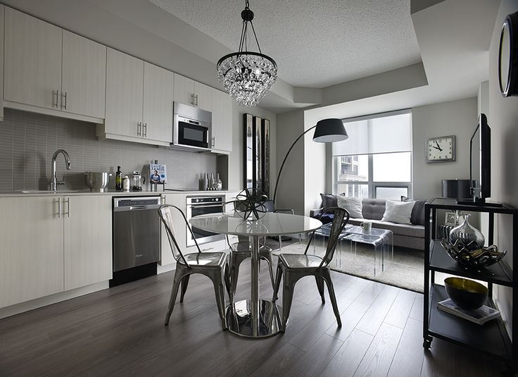 The Kitchen and Living Area of the #Decorium #ModelSuite at #WestVillage Etobicoke.  Open concept design and clean, contemporary finishes and style.