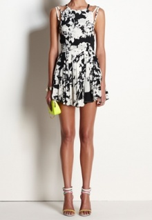 FLORAL SKIES is a high neck mini dress with strap detail, pleated skirt and is s