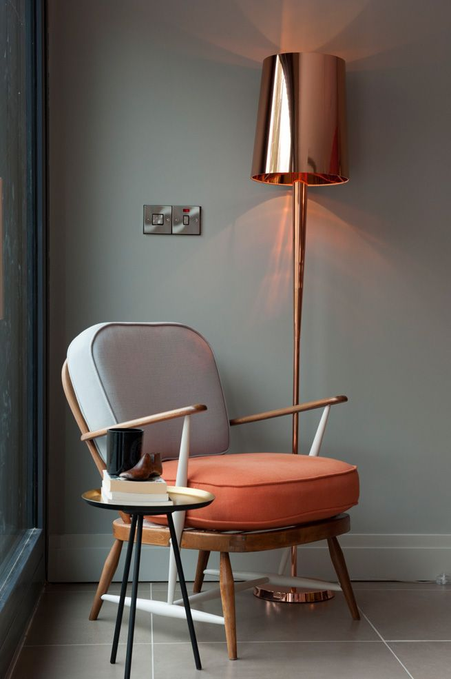 Colourful armchair & copper lamp for a design corner