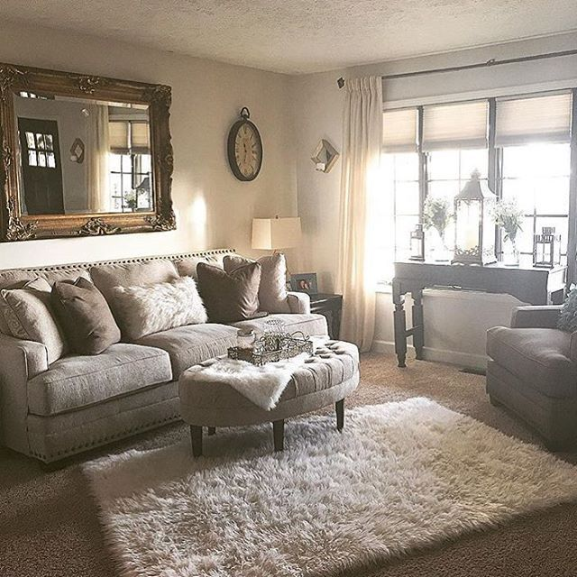 We are obsessed with how gorgeous this living room is! @joanna0023 did an amazing job styling her Cloverfield Sofa by Ashley Furniture with stunning glam decor! That mirror, pillow and layered area rug on carpet is taking our breaths away! Could this be any more beautiful?
