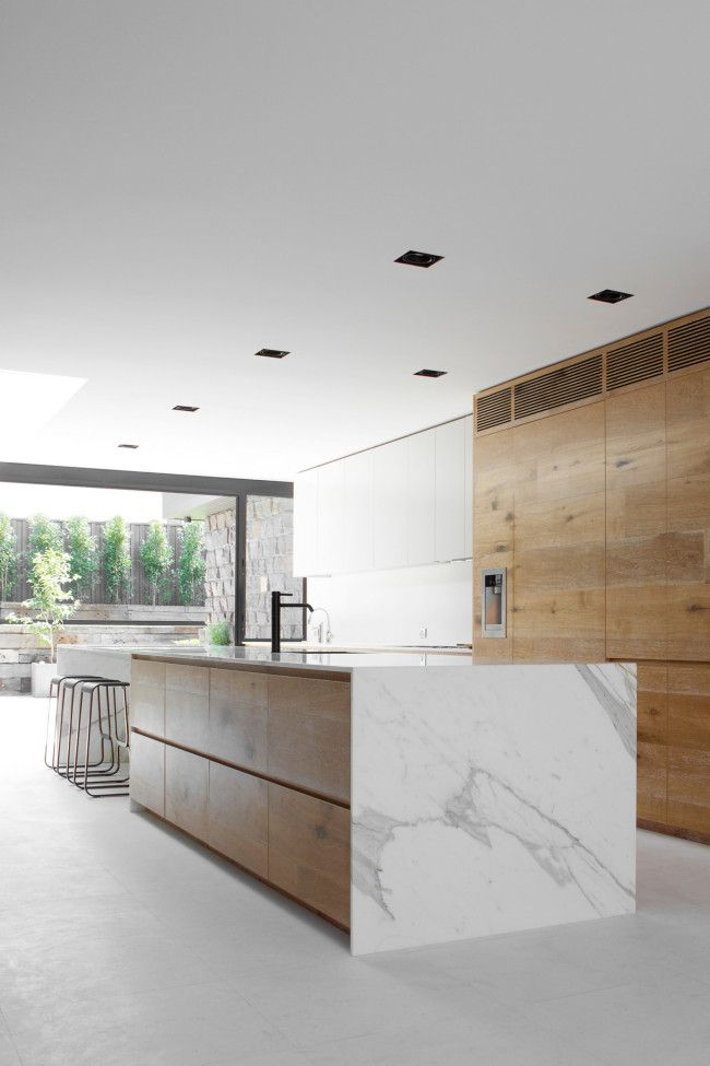 white contemporary kitchen, wood, marble, black faucet, large scale drawers, the rustic wood's colour & finish is a nice counterpoint to the smooth modern finishes, indoor outdoor living
