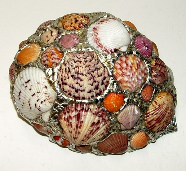 Abalone Shell Bowl That Is Adorned With Scallop Shells