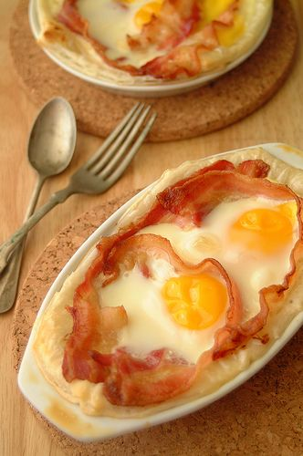 Bacon & Egg Breakfast Pies. These puff pastry tarts look delish, but I have a thing about soft bacon. I know it's cooked, but I only like bacon when it's crispy. The buried edges of this bacon would never crisp, so I wouldn't like it. But here's the recipe if any of you are interested. :)
