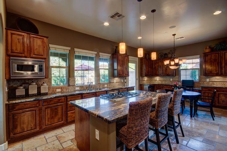 Stainless steel appliances, kitchen island, breakfast bar, lighting, kitchen, Arizona Real Estate