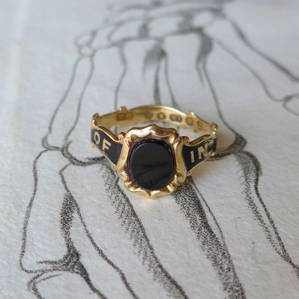 "18k yellow gold mourning ring. Beautiful scrolling band with words ""in memory of"". Unique shield shaped face with an onyx oval. Inside inscription says, ""Anne Waters, May 24,1855. Fully hallmarked, British origins. Size 8.5"