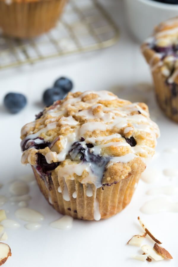 Blueberry Almond Coffee Cake Muffins - coffee cake filled with fresh blueberries and topped with almond crumble and sweet glaze!