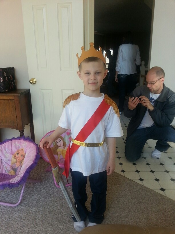 Hayden's Prince Charming outfit I made this morning with a white t-shirt, ribbon & upholstery trim. All with hot glue & safety pins.