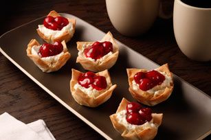 This is a simple twist on a classic cheesecake recipe combination. The creamy taste of cream cheese and sweet cherries make these tiny treats a great dessert to serve at your next special occasion.