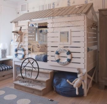 great room for kids with a beach-cabin-style playhouse