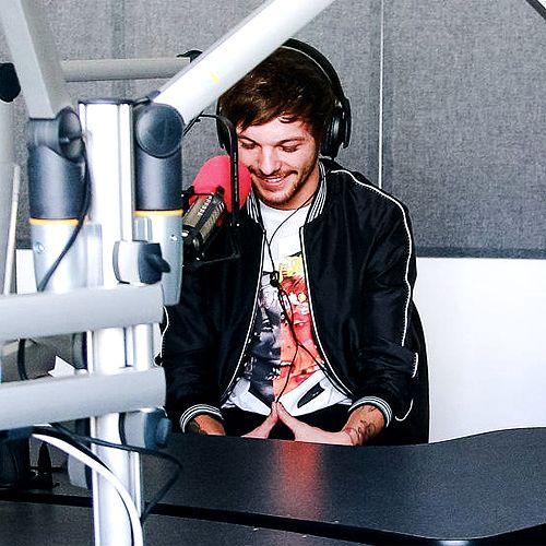 It looks like he is making a heart