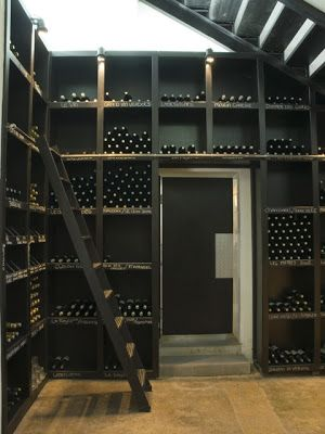 Do this against one wall in stoarge for each bottle.   Wine Room in black and timber  #wineroom