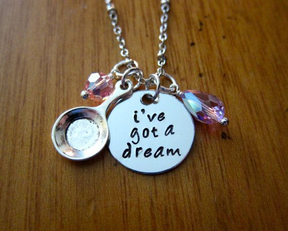 Tangled being my favorite princess I need this necklace! It literally has a mini frying pan on it!