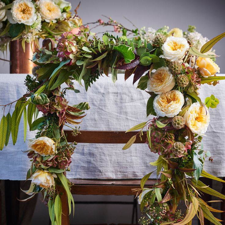 Fall Wedding Trends: Fall Wedding Flowers Chair Garland. How to DIY Wedding Flowers with The DIY Wedding Planner #fallwedding ideas #fallweddingcolors #fallweddingflowers #falldecor