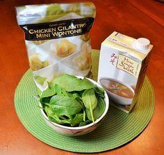Easy 10 minute Wonton soup, Trader  joes, miso stock, pkg wontons, greens.