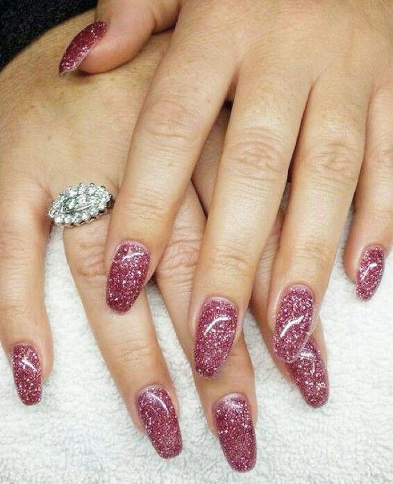 Dusty rose pink glitter gel nails in a rounded coffin ...