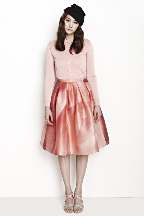Yoo In-young in her pink element is striking a pose.