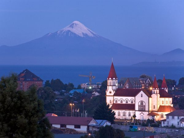 The Iglesia del Sagrado Corazón overlooks the city of Puerto Varas, pristine Lake Llanquihue, and one of the Lake District's stunning snowcapped volcanoes. The church, constructed during World War I, is modeled on the Marienkirche of Germany's Black Forest and reveals Chile's strong European roots. Most Chileans trace at least some of their ancestors back to Europe; only around 5 percent are indigenous peoples.