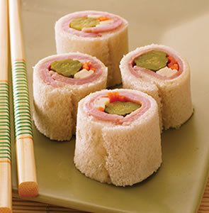 Looks like sushi, but these are filled and rolled toast slieces!! Great idea as a Starter!!