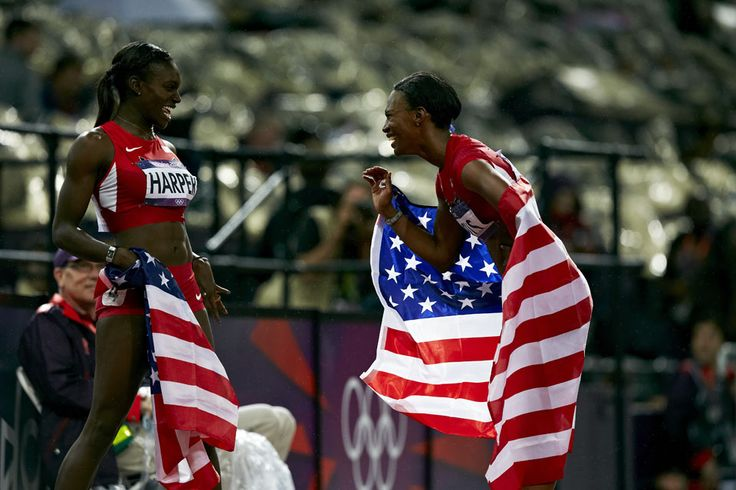 London 2012 - Dawn Harper and Kellie Wells celebrate silver and bronze respectively with big smiles and American flags.  IOC/John Huet