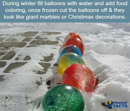 Giant christmas balls made from frozen water balloons with for Water balloon christmas decorations