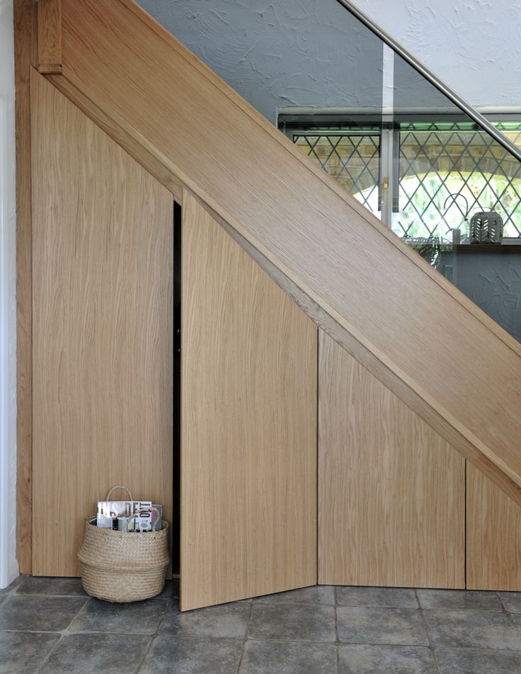 Oak staircase with clever under-the-stair storage solution.