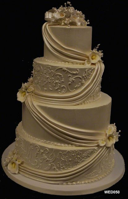 WED050 4 tier ivory round wedding cake with flowers and swags 50 78 by 3 Brothers Bakery, via Flickr